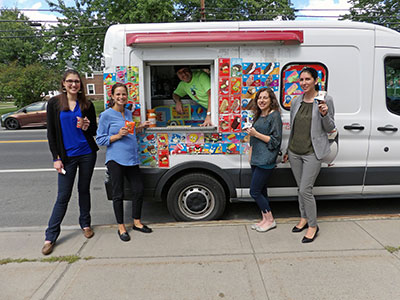 employees posing outside ice cream truck