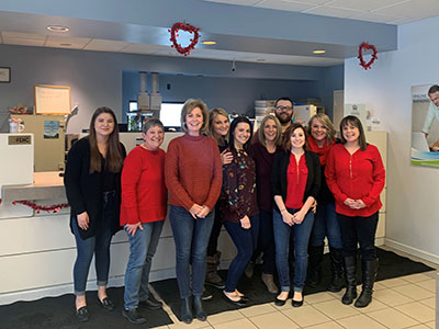 Plattsburgh West Employees Wearing Red