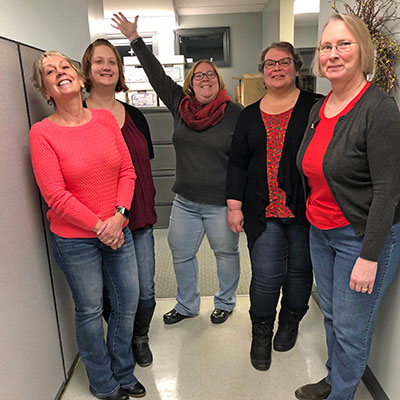 Deposit Operations Employees Wearing Red